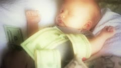 Newborn baby with pile of money on him Stock Footage