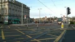 LUAS Tram moving past Heuston Station, Dublin Stock Footage