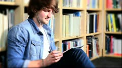 Caucasian classmate listening to mp3 player and study  - stock footage