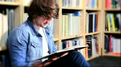 Male studying textbook for degree in hub  - stock footage