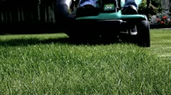 Home owner cutting grass on riding lawnmower Stock Footage