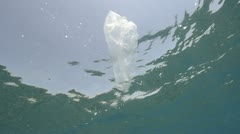 Plastic bag in the ocean - underwater view Stock Footage