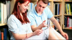 Graduate students study on tablet in hub  Stock Footage