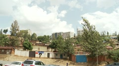 Pan across old and modern buildings in the Rwandese capital, Kigali Stock Footage