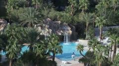 Resort swimming pool tropical waterfall P HD 9749 Stock Footage