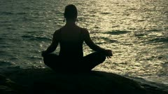 Girl practices yoga near the ocean Stock Footage