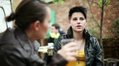 Young female friends drinking beer and chatting in bar, steadicam shot HD Stock Footage