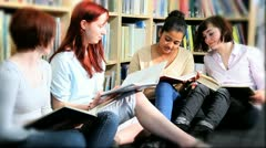Female students researching knowledge on books    Stock Footage