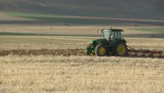 with tractor plowing fields - stock footage