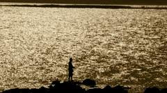 Sepia fisherman on Rio de la Plata. Montevideo/Uruguay Stock Footage