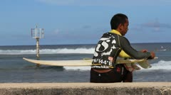 Surfer Preps his Board Stock Footage
