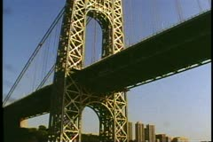 The George Washington Bridge, East Tower, pass under on The Hudson River Stock Footage