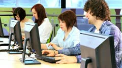 Team of classmates using online education in  IT library  Stock Footage