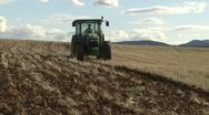 With tractor plowing fields Stock Footage