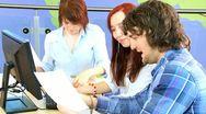 Team of classmates focus IT application online   Stock Footage