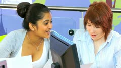 Multi ethnic classmates using college information hub  - stock footage