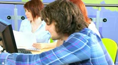 Students studying social networking in library  - stock footage
