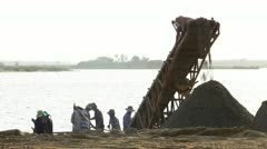 Builders at the river with transporter - stock footage