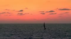 Sailing under Orange Sky Stock Footage