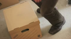 Picking up a box correctly Stock Footage