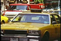 Taxicabs on Fifth Avenue in New York City in 1995, bunched together Stock Footage