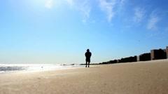 Boy Walks Along Beach Under Bright Sunlight (defocused) Stock Video Stock Footage