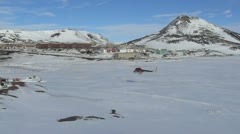 McMurdo Station Antarctica Helo landing near Scott's Hut. - stock footage