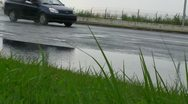Stock Video Footage of low perspective cars rain road