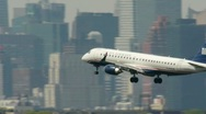 US Airways Airplane approaching fly into New York City arrival Manhattan Stock Footage