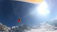 Paraglider using thermals to manoeuvre parachute - stock footage