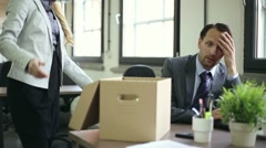 Shocked young businessman is getting fired by his boss HD - stock footage