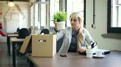 Just fired, sad businesswoman packing on belongings to the box HD Stock Footage