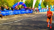 Stock Video Footage of Female Marathon Runner In Slow Motion