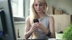 Businesswoman sending sms, texting in the office, steadicam shot HD - stock footage