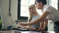 Businesswomen working by the computer in the office, dolly shot HD - stock footage