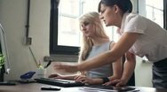 Businesswomen working by the computer in the office, dolly shot HD Stock Footage