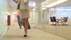 Businesspeople dancing down hallway - stock footage