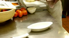 Cooking food in kitchen Stock Footage