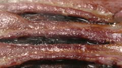 Close up of bacon frying Stock Footage