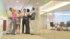 Busy office workers meeting in hallway Stock Footage