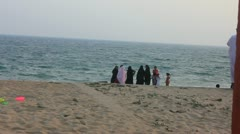 Women in Burqas at Karachi Beach Stock Footage