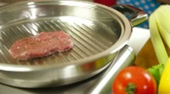 Stock Video Footage of Raw Steak Grilled On Grill Pan