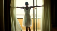 Stock Video Footage of Girl opens the curtains in the morning and go out to the terrace, slow motion HD