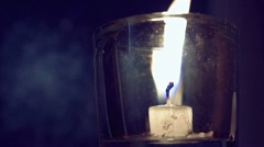 Candle burns to ashes in a glass Stock Footage