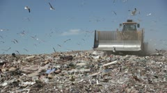 Large truck compacting trash at a county landfill HD602 Stock Footage