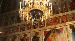 Chandelier and icons of saints in church Stock Footage