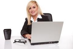 efficient businesswoman working on her laptop - stock photo