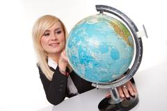 woman planning her dream holiday - stock photo
