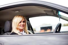 Attractive blonde behind the wheel Stock Photos