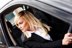 Attractive woman reversing a car Stock Photos